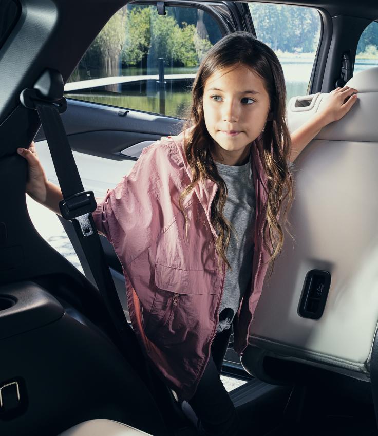 Little girl admiring Mazda CX-9