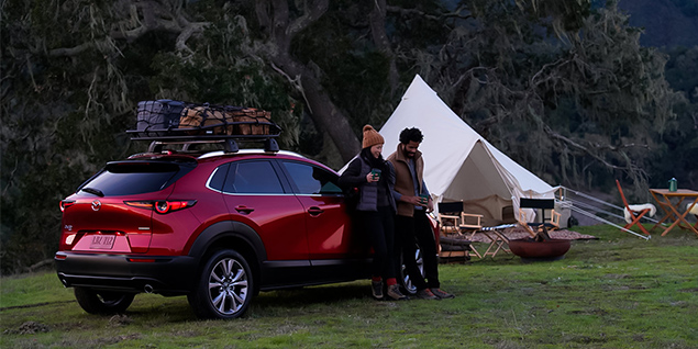 Mazda CX-30 parked in front of a scenic view