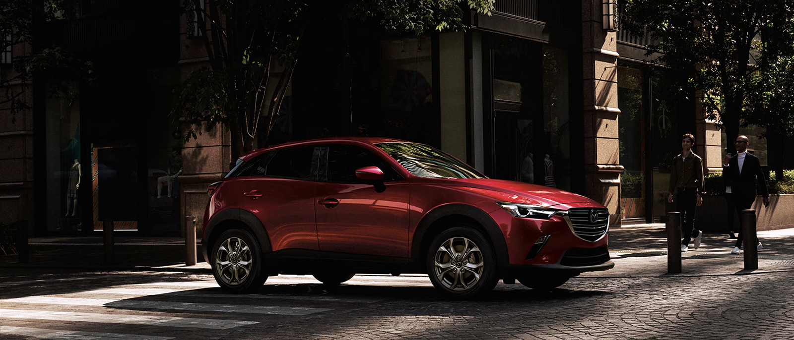 Red Mazda CX-3 parked in a street