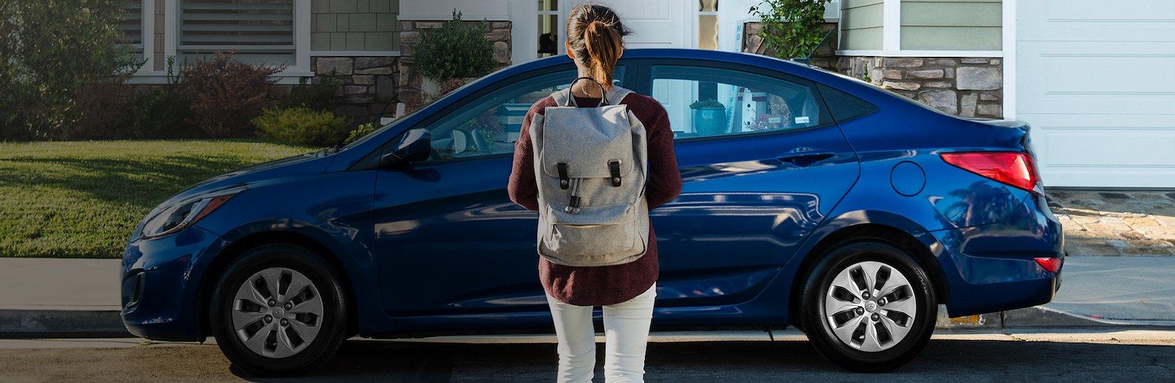 A Student standing next to a Hyundai car