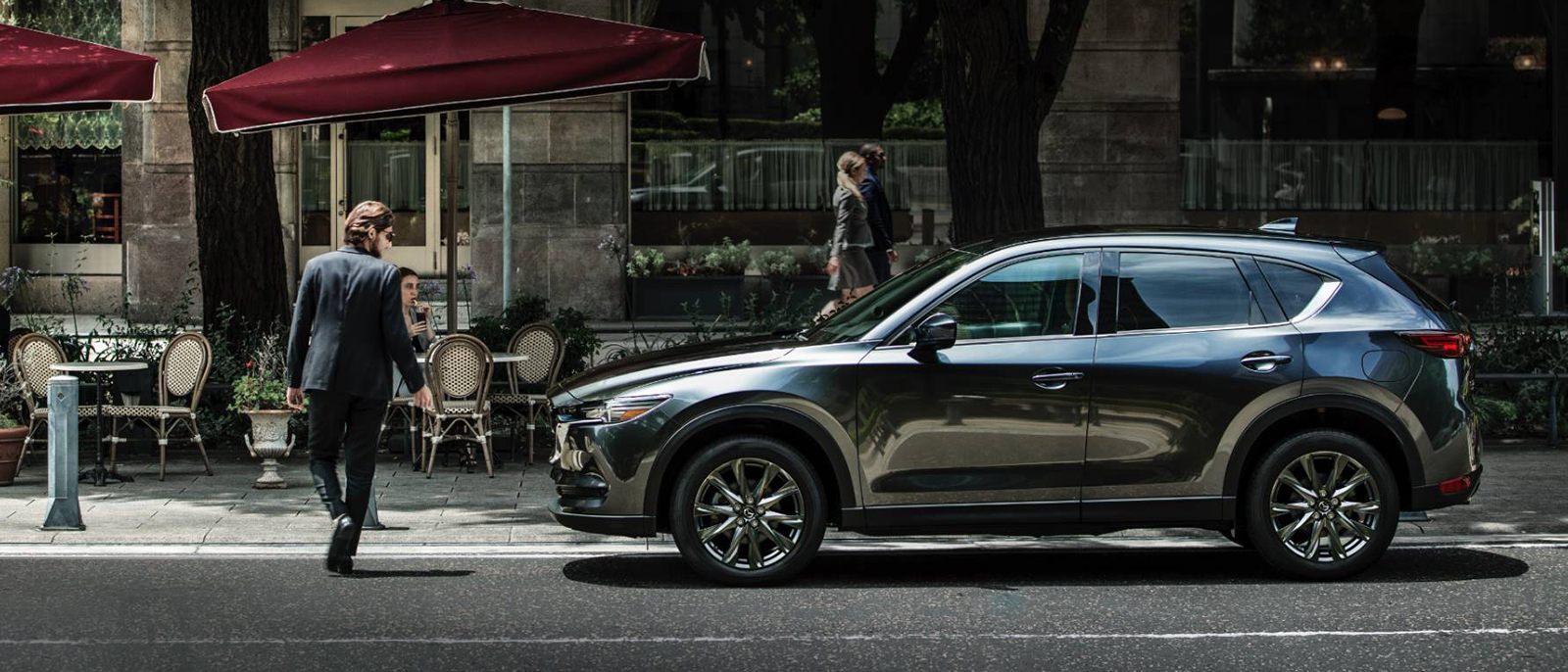 Gray Mazda CX-5 driving on a road