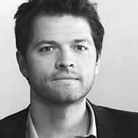 Black & white portrait of Misha Collins.