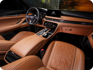 Interior view of an INFINITI QX60 in Saddle Brown leather.