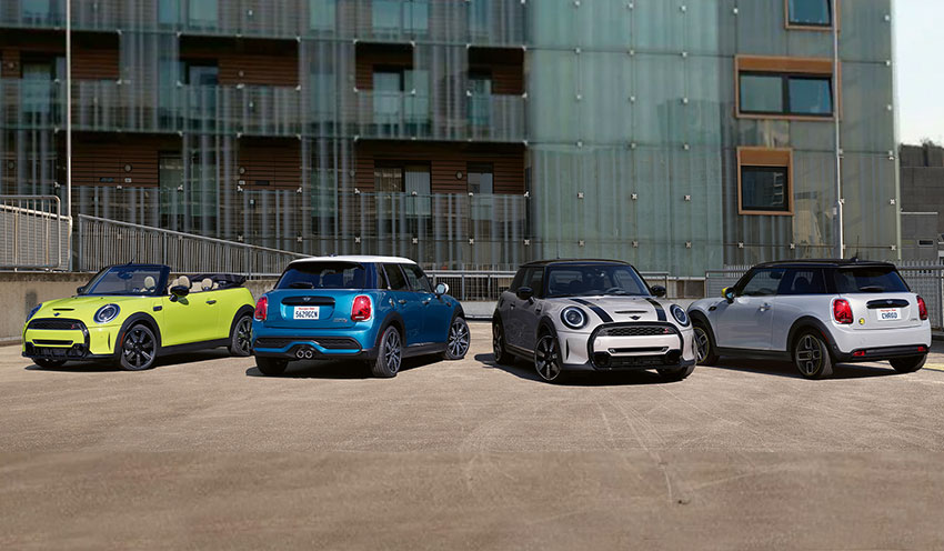 The 2022 MINI Hardtop 2 Door, 2022 MINI Hardtop 4 door, 2022 MINI Hardtop Convertible, and 2022 MINI Electric Hardtop 2 Door parked in a courtyard